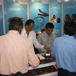 Customers at exhibition of industrial belts